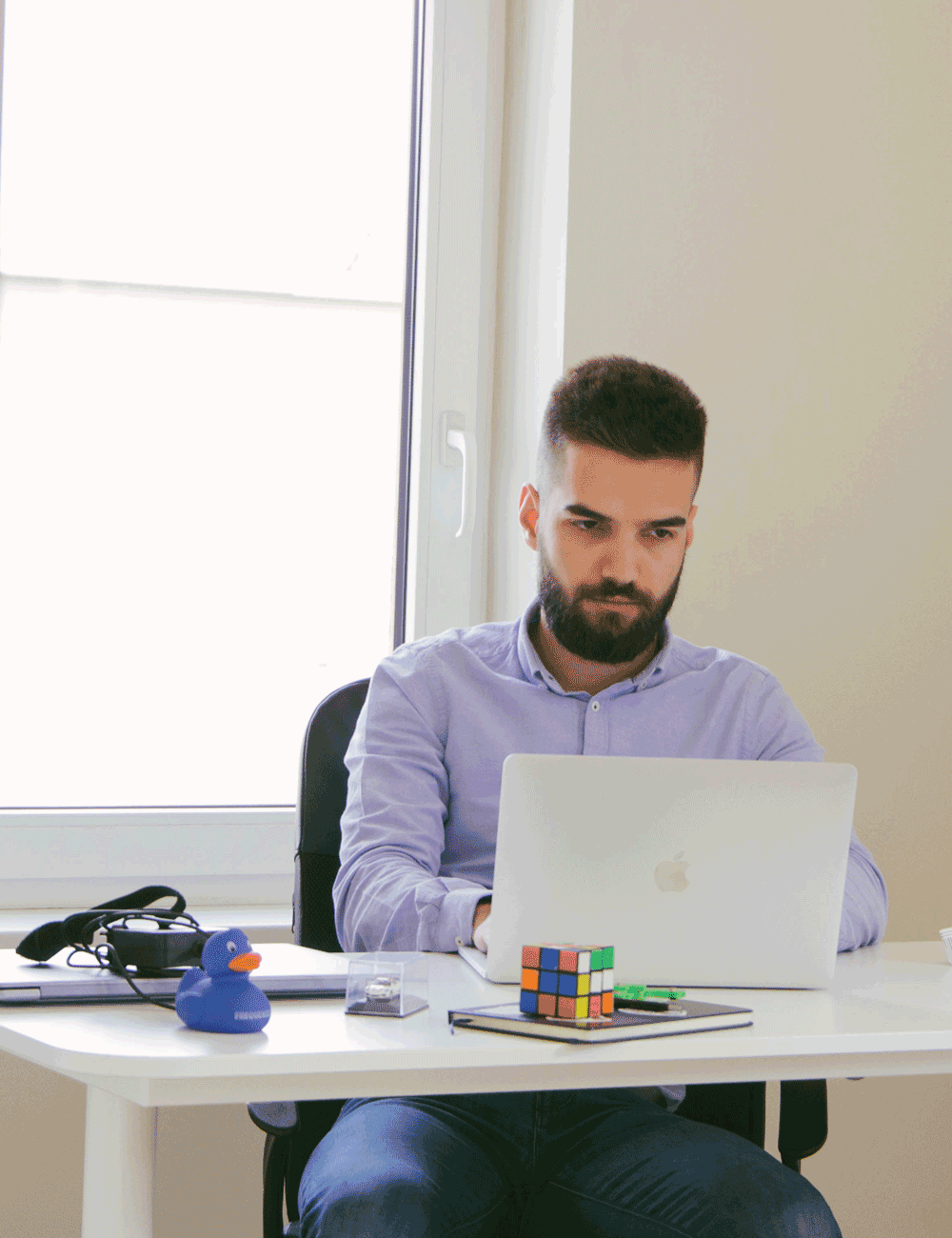 Software engineer working at his desk at Take Off Labs